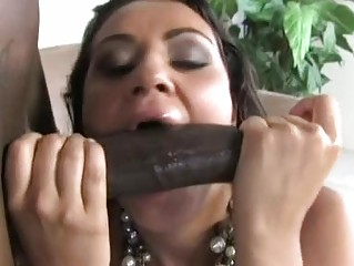 Cock sucking brunette slut gets huge black cock up her hairy minge