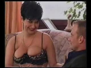 Angel in corset feeds him her tits