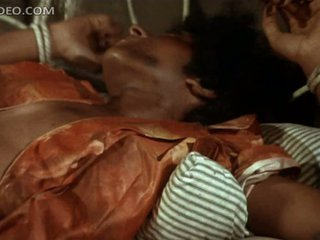 Insanely Busty Ebony Babe Pam Grier Unties Herself In Ragged Garments