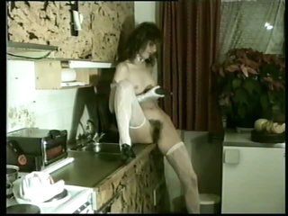 Sexually excited Maid Debbie Van Gils Crams a Cucumber Up Her Hairy Pussy