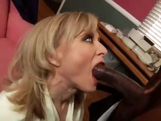 Lewd Nina Hartley with a black stud
