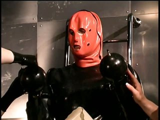 Perverted Dominatrices With a Latex Fetish Suffocate a Submissive Male