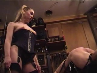 Domina in Stockings Spanks Belts and Canes