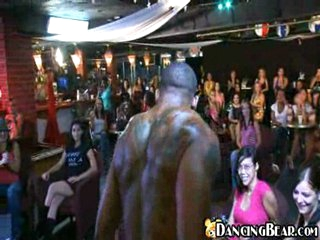 Girls enjoying show of naked stripper