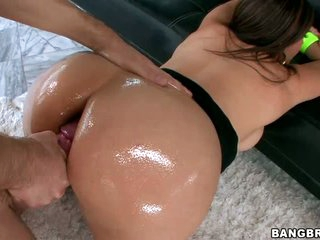 Sexy brunette MILF Raylene gets her big oiled tattooed butt filled with inflexible dick. She goes crazy about butt fucking. Her sex partner is a well hung guy and she enjoys his nice size love tool.
