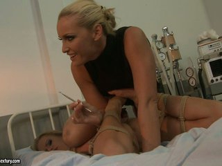 Kathia Nobili and Mandy Bright patient tied on bed