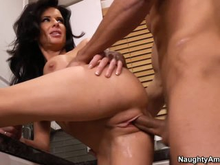 Veronica Avluv has a nice time with her son's buddy Marco Rivera in the kitchen. They are alone in this house and no thing can stop big titted brunette woman from enjoying his dick in her mouth and pussy.