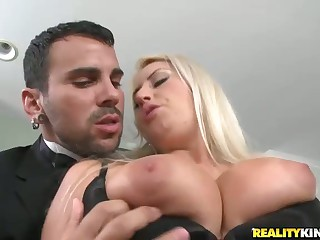 Big meloned blonde Chantelle Sky in sheer stockings wears black dress with black thong panties. Her elegant piano teacher can't resist her amazing big tits. Chantelle Sky opens her legs as soon as he grabs her boobs. Watch them fuck hard beside the pian
