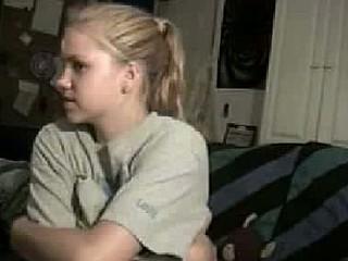 Blonde cutie chatting on webcam