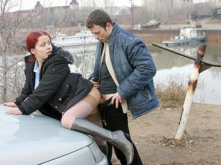 Redhead student sucks on the banks of the river for all to watch
