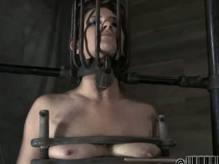 Restrained beauty is hoisted up for her sexy torment