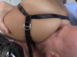 A whore with a strap on teases and fucks her male partner