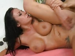 Tattooed brunette with massive honkers gets drilled sideways