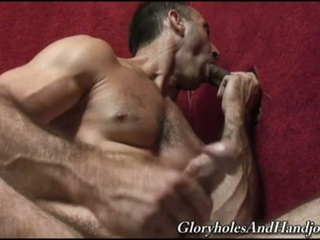 Homo hunk jerks while sucking cock