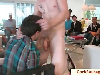 Lad gets his cock sucked at party