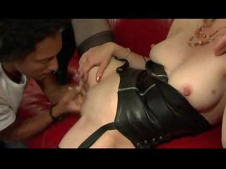 French brunette wears leather and loves black cock