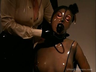 Blonde Goddess Makes Breasty Unrepining Brunette Wear Suffocating Latex Suit