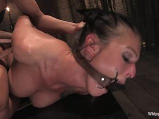 Tied up and gagged slut acquires fucked in the ass with a dildo by another whore.