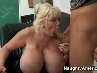 Kayla Kleevage enjoys giving a young boy a lusty blowjob one night
