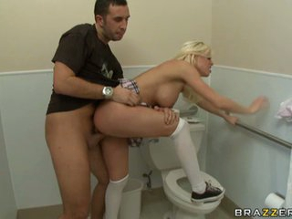 Hawt blond slut Britney Amber being fucked hard over a toilet