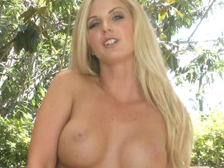 Charming Natalie Nice with long blond hair. well shaped tits. juicy ass and smooth pussy does sexy striptease before riding a toy. She bounces up and down with dildo in her pussy!