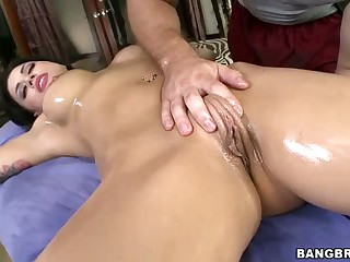 Eva Angelina with big tits and meaty pussy gets on her back and enjoys massage totally naked. Soon she takes masseur's cock in her wet hole. And then it comes to ass fucking.