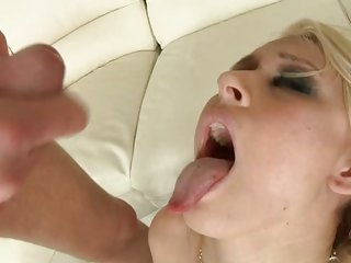Katie Summers gets her face sprayed with jizz