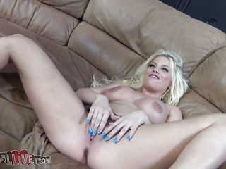 blonde babe masturbating on the couch before sucking a cock