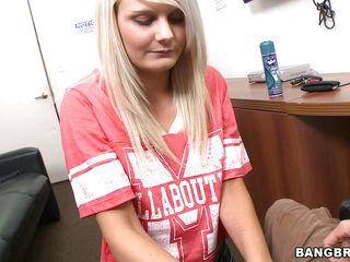 horny blonde giving a guy a handjob