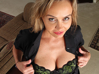 Hot milf hooker is exposing her fine boobs on camera