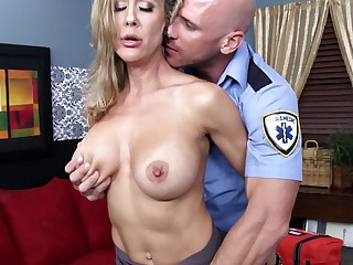 Blonde lady is getting fucked by an ambulance guy on the sofa