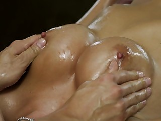 A beauteous removes her overcoat and she gets massaged by her masseur