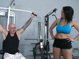 Dark haired pornstar with huge puppies receives banged in gym