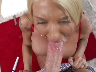Tattooed golden-haired gobbles down a stiff fuck shaft