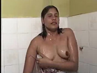 Curvy milf takes a wet shower