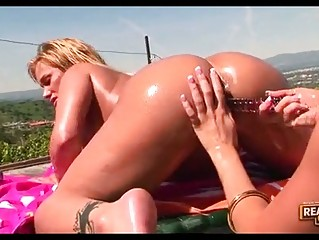 2 bootylicious lesbian pornstars playing with dildos outdoor