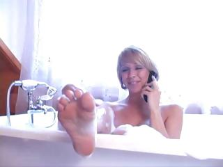 Mature blonde gets her butt licked by her submissive hubby in the bubble baths