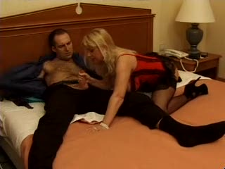 Milf in corset and nylons has sex