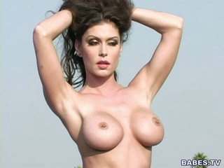 Kinky little Jessica Jaymes poses nude after stripping outdoors