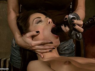 Mandy Bright screw a hot babe's mouth with black dildo