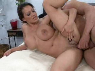 While playing with her massive tits, Ava Lauren takes a coarse ramming
