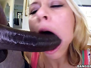 Blonde Katie Summers is a brave lady. Wesley Pipes' huge long black dick is for her. He explores her pussy with fingers and fucks her mouth rough before she takes his snake in he wet hole from behind.