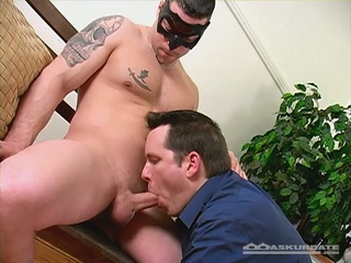 Masked tattooed stud gets blowjob by hunk