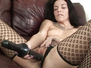 Aria Aspen rams her massive toy deep in her moist pussy