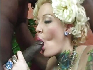 Horny Candy Monroe gobbles down this black skin flute