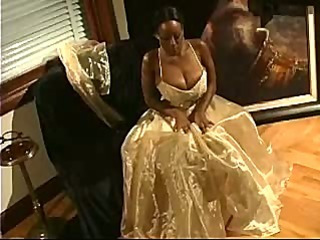 Black girl in ball gown plays with big tits