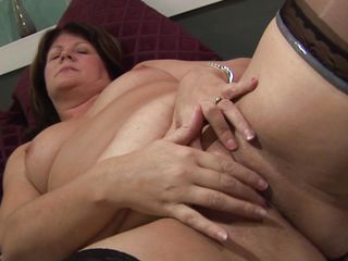 horny mature lady fingering her pussy to make it wet