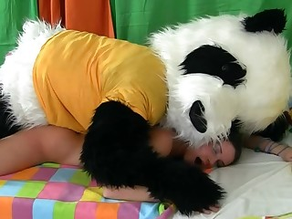 Hot woman is getting fucked by a guy that is in a panda vestment