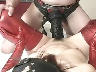Fucking a hoe with a huge strapon dildo