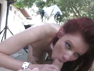 Voluptuous redhead shoves a huge jock down her throat